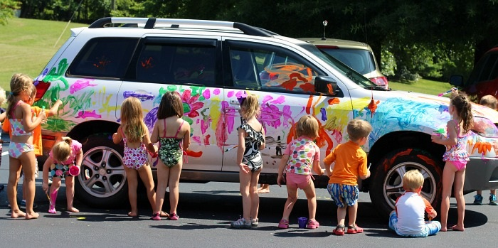 Collaborative-fun-art-project-for-kids-painting-and-washing-a-car-together